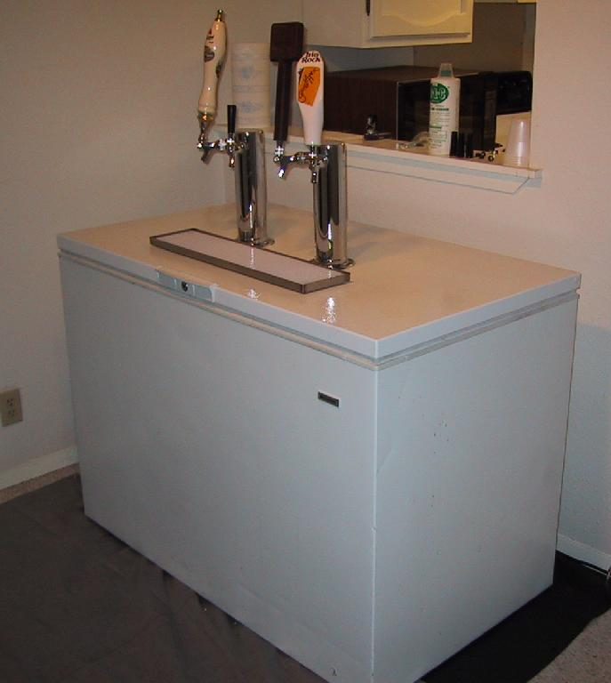 this is the latest kegerator i converted this chest freezer to just with a new thermostat it holds 2 commercial kegs of beer and has room for